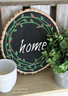 Learn how to paint a simple winter wreath and create a wood slice painted wreath that will last all winter long. Such a great DIY Christmas craft