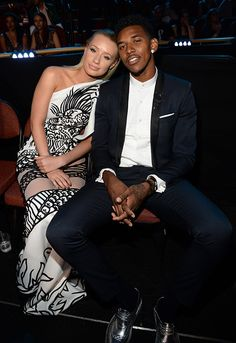Iggy Azalea and Nick Young. Perfect photo. Relaxed. Oozing style....