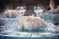 Orchids and roses on Tiffany Blue cloth-add peach colored flowers