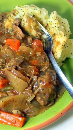 EASY Boeuf Bourguignon (Beef Stew)  with Herb Dumplings and Garlic Mashers in a Slow Cooker  MY FAVORITE SLOW COOKER RECIPE... For me, the real beauty of the recipe is the rich thick gravy. The gravy just demands something to soak up the goo. Pour this over the potatoes and you have that perfect combination of taste and heart warming comfort food.  I would eat this everyday for the rest of my life!