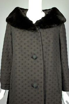 http://www.vivavintageclothing.com/site/largepics/703/125077/419711/573313/C117-black_&_brown_wool_1960s_coat_fur_collar_-_2.