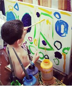 Joey Dazzio, age 4, painting an abstract painting on a 24x36 inch stretched canvas with acrylic paint.