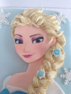I've been waiting ages to do a frozen cake and finally in the middle of this gorgeous hot weather I find myself making sugar snowflakes! Loved making this cake although I was a bit nervous when it came to painting elsas face. I have to do this...