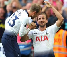 Harry Kane of Tottenham celebrates scoring their 3rd goal with Christian Eriksen of Tottenham during the Premier League match between Tottenham...
