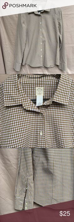 """The Perfect Shirt by J. Crew Perfect shirt in medium Gingham.  Iconic menswear inspired motif. Borrowed from the boys cut designed and tailored for women-that's why it's called perfect- precisely placed bust darts and back princess darts for a slimming, waist-defining fit. Like new.  100% cotton Machine wash Length 27.5"""" Armpit to armpit 19.5"""" J. Crew Tops"""