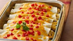 Delicious, yet lower in fat and calories with Greek yogurt and reduced-fat cheese in these yummy enchiladas.