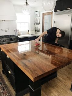 It's been 2.5 years since we installed our black walnut countertop from CraftArt (more on that here) in our kitchen and this past weekend we took some time to refinish it. The wonderful thing about