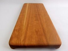 This stunning piece of functional art includes beautifully handcrafted Cherry woods. This cutting board is the natural color of the wood – no stains or dyes are used. Therefore the beautiful grains can be seen and the board is 100% food safe. The board comes with non-slip rubber feet with... see more details at https://bestselleroutlets.com/home-kitchen/kitchen-dining/cutlery-knife-accessories/cutting-boards/product-review-for-handcrafted-wood-cutting-board-edge-grain-c