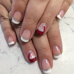 Santa hat nails and French with glitter accent line by NailsArt Wilmington, NC.