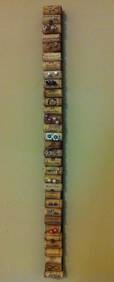 Post earring holder. Scrap wood, corks, hot glue
