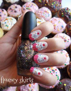 Cupcake Nail Art  Base coat: Essie - Sand Tropez  Pink holder: Gilly Hicks - Pink Topaz  Cupcake: Sally Hansen - French Tip  Cherry: Red Sharpie  Sprinkles: Sephora by OPI - Sparktacular