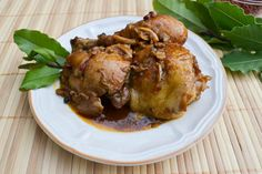 Chicken Adobo is a popular Filipino recipe with chicken slowly cooked in garlic, vinegar, bay leaf, black peppercorns and soy sauce.