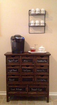 My coffee/tea bar. The cabinet is from Hobby Lobby. The wall shelf is from Gordmans.