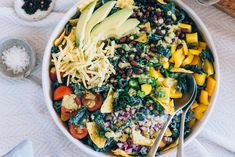 In this wholesome take on a Tex-Mex taco salad, shredded kale is tossed with hearty black beans and crisp veggies, and softened by a creamy yogurt and cilantro dressing. And of course, no taco salad would be complete without crunchy tortillas and plenty of shredded cheddar. So if you're looking for a more exciting way to get your fill of kale, this is it!