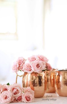 You might already know that I have a huge love of fresh flowers-and I also have a love of creative ways to display them. From buckets, to copper mugs, to vintage cordial glasses and even garbage cans-. Copper And Pink, Copper Rose, Hammered Copper, Copper Mule Mugs, Pink Und Gold, Pale Pink, Deco Rose, Copper Decor, Rosa Rose