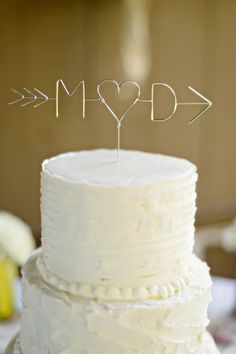 Unique wire arrow, heart, and initials word cake topper