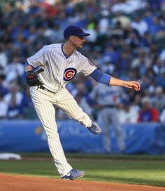 Cubs starting pitcher Chris Rushin follows through on a delivery to the Los Angeles Dodgers in the first inning of a baseball game in Chicag...