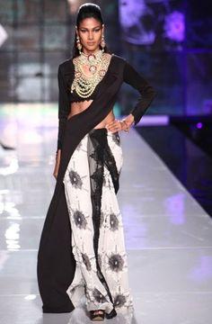A deconstructed tuxedo inspires Masaba Gupta's sari-gown for Satya Paul.