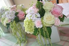 Delicate floral arrangements throughout the space. Keep table arrangements short and compact. Large arrangements are suitable for the wedding day.