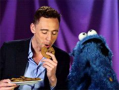 (gif) LOL! He looks like he's trying not to laugh as Cookie Monster goes crazy.