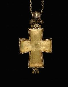 anotherboheminan: BYZANTINE JEWELRY 11TH CENTURY Gold and enamel reliquary cross, Byzantine, early 11th century.This is a view of the closed pendant. The reverse of the pendant depicts the Virgin Mary with St Basil the Great and St Gregory Thaumaturgus. This small pendant has been found on the site of the Great Palace at Constantinople.