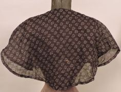 """1830s clover leaf print muslin pelerine; hand sewn; rounded in back with wide nothes on each arm rounding again in front; neck: 13.5""""; length: 14"""""""