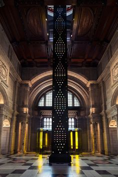 London designer Kim Thomé's Zotem installation features patterns of faceted crystals that appear to rise up 18 metres through the V&A museum's grand entrance.