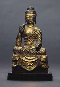 A GILT-BRONZE SEATED FIGURE OF BUDDHA THREE KINGDOMS PERIOD-UNIFIED SILLA DYNASTY (7TH CENTURY) Seated dhyanasana with legs crossed in the pose of meditation and with the hands in the vitarkamudra, wearing distinctive drapery of narrow diagonal folds that end in scalloped layers at the hem, the reverse showing the slender back of the figure and a lappet-shaped section of drapery from the shoulder, the interior hollow; richly gilt overall save the coiffure 5 5/8 in. (14.3 cm) high