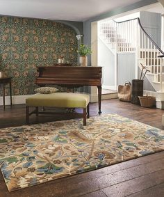 Lodden Rug The beautiful Lodden design by William Morris features intricate scrolling flowers and delicate foliage in blues, green & soft pink.