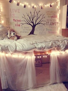 The tree, words, hanging pictures, and pillow look cool together