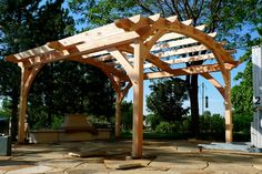 A beautiful timber frame pergola is a great addition to any yard. This beauty by TFBC member High Plains Timber Frames.