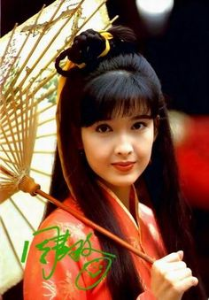 Beauty in ancient Chinese garment.   Vivian Chow, Hong Kong mega star actress/singer of the 90's.   Chinese fashion and cosplay