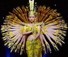 Tai Lihua, art director of China Disabled People's Performing Art Troupe, leads deaf dancers to perform 'Thousand-hand Avalokitesvara Bodhisattva', or 'Guan Yin', a Chinese goddess, in Suining, Sichuan province.
