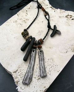 Kathy Van Kleeck - steel and bronze metal clay with fossilized bone fragments