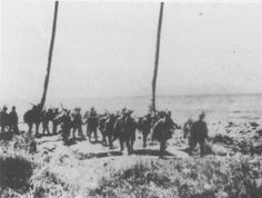Japanese soldiers march along the shore of Guadalcanal in September 1942 during the Guadalcanal Campaign.