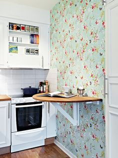 This little wall mounted drop leaf. Great for breakfast/dinner in the kitchen or extra counter space when needed