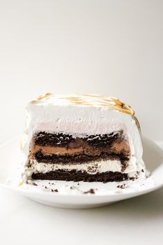 Baked Alaska recipe from the Wood and Spoon. This is a simple dark cocoa chocolate cake layered into a bread pan with store bought ice cream. The layered rectangle cake is frozen and then coated with fluffy French meringue before being toasted. the recipe for this classic vintage dessert comes from Jessie Sheehan new book. Find the recipe and how to for this summer dessert on thewoodandspoon.com
