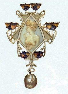 Lalique 1900-02 signed 'Female half-Figure' Pendant/Brooch: shaped with a female head & torso in low relief on the central ivory plaque. The frame is of white-&-lavender glass poppy blossoms whose stems form a symmetrical pattern of beige enamel & gold. A baroque pearl hangs from the base. Acquired from the artist in 1901. Calouste Gulbenkian Museum