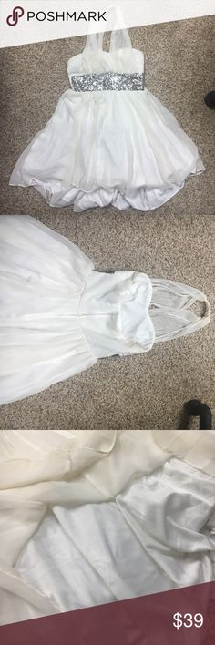 Beautiful white baby doll stress 👗😍 White baby doll dress with a silver glitter band, easy to tuck strap and make strapless. Perfect condition only worn once 🤗🤗👗🔥 Deb Dresses Prom