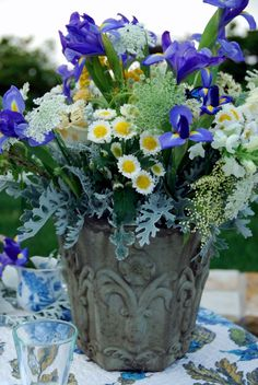 Iris and button daisies w/ misc white flowers and dusty miller as filler - I like this quite a bit.