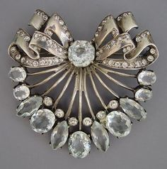 EISENBERG Original sterling brooch with unfoiled larger pale blue and foiled clear rhinestones, circa 1940, 2-1/2.