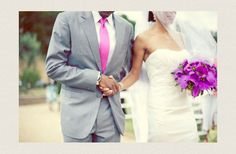 groom in grey suit hot pink tie bride wears white lace wedding dress