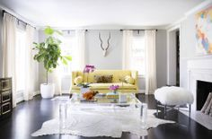 Sally Wheat Interiors, Domino Magazine, living room, yellow sofa, lucite coffee table, fur bench, leopard pillow