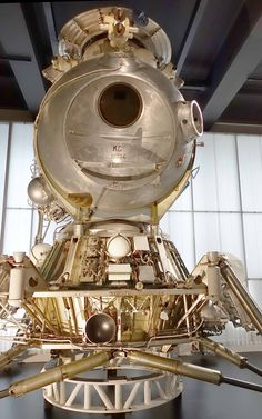 https://flic.kr/p/FFz54z | Soviet LK-3 Lunar Lander, Lunniy Korabl | Control system was the first in the Soviet program based on an onboard computer. Inputs were derived from a three-axis gyro stabilized platform, landing radar, and a collimating sight.  The cosmonaut would use the sight to spot the selected landing site, and then input the coordinates to the computer. Computer commands were verified using Sun and planet sensors.  Lone cosmonaut stood before a large, round, downward-angled…