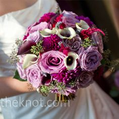 Purple and White Bouquet  Victoria matched her bouquet with the bridesmaids' dresses to contrast with her own gown. She carried dark purple and Picasso lilies, dahlias, blue and green hydrangeas and lavender