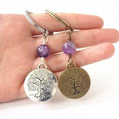 tree of life keychain, family tree keychain, world tree, spiritual gifts, Good Fortune, amethyst bead. Key ring measures about 1 inche(2.7cm) Tree of life charm size: 24mm or 0.9 inche Amethyst bead size: 10mm Choose silver or bronze keychain in product options Comes in gift box ready for gifting.