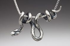 Silver Vine Snake Pendant by martymagic. Love the way the snake is on the chain!