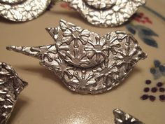 Bird pin using SU punch  embossing folder and aluminum tape - so pretty!