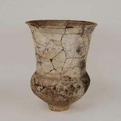 Description Earthenware storage jar, ovoid shape with red-on-buff colors, from recent excvations from Ban Chiang kilns, Northeast Khorat Plateau, Thailand, 500 BC, restored.
