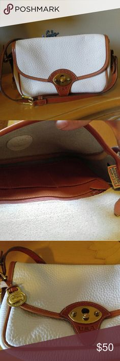 *Rare* Dooney and Bourke bag White pebbled leather Dooney & Bourke Mystery Calvary bag. Long Brown leather strap and brass hardware. Gently used and is in fabulous condition. Dooney & Bourke Bags Shoulder Bags